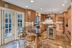 Gourmet Kitchen with Viking Appliances and Travertine Floors