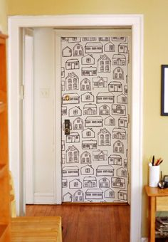 "Cover your door with starch and water and you can ""wallpaper"" fabric to any surface and when you're sick of it, simply pull it off!  Totally genius!"