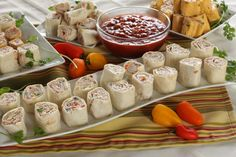 Jalapeno Cheddar Roll Ups - Fabulous roll up with refried beans, diced tomatoes and chilies, cream cheese, green onions and red pepper. These use jalapeno cheddar wraps for more heat. #roll ups #tortillas #appetizer #snack #refried beans #wraps #sandwiches #tex-mex