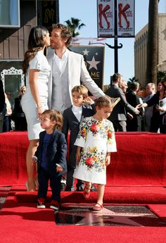 Celebrity dads ~ Matthew McConaughey kisses his wife, Camila Alves, as he stands with his sons, Livingston (front L) and Levi(C) and daughter, Vida ~ ceremony honoring him with the 2,534th star on the Hollywood Walk of Fame, Nov., 2014.
