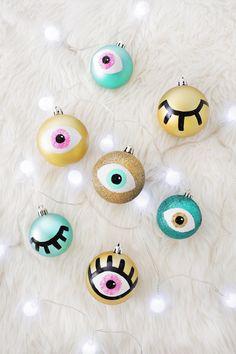 DIY painted eye ornaments.
