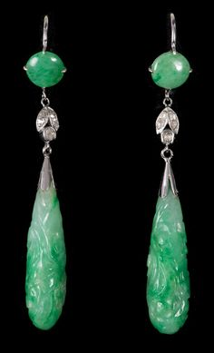 Pair jadeite and diamond drop earrings, each with a Chinese carved green jadeite drop suspended from a rose cut diamond mount, with a further green jadeite panel, on hoop fitting, in box, retailed by Johnson, Walker & Tolhurst Ltd., London, 60mm