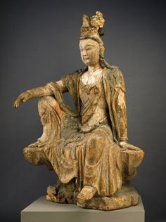 Collections - SAM - Seattle Art Museum SEATED GUANYIN 10TH - LATE 13TH CENTURY CHINESE It is said Guanyin presents himself everywhere in the world to save people from suffering, and assumes various forms to carry out his mission. The form that has become most popular in China since the 10th century is the female Guanyin, such as this graceful example from the Song period.
