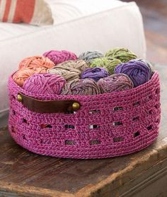 This crochet basket pattern from our friends at Red Heart yarns has a sturdy construction and stylish leather handles. The Grape Cordial basket is an easy pattern that's worked up in the round, and the yarn it's worked up in is more like a cord than string, helping the basket keep its shape. Choose a color that would match your decor and crochet your own basket that's stylish and simple and begging to be displayed.