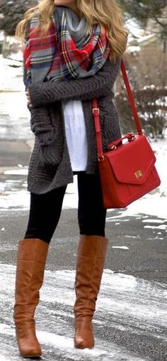 Woman with brown boots, plaid scarf and matching red sling handbag