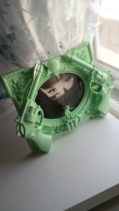mint green cowboy gun picture frame by CheeseCrafty on Etsy, $25.00