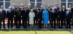 US president Barack Obama and Russian president Vladimir Putin pose during a group photo. Also pictured are Ukraine president-elect Petro Poroshenko, Slovakia's president Ivan Gasparovic, Norway's King Harald, Britain's Queen Elizabeth, French president Francois Hollande, Denmark's Queen Margrethe II, Luxembourg's Grand Duke Henri, Netherland's King Willem-Alexander and German chancellor Angela Merkel