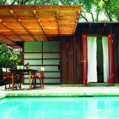 Rustic former horse shed becomes poolhouse / guesthouse.  Los Angeles.