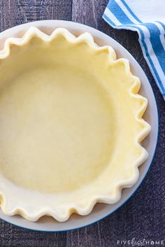 Butter Pie Crust ~ this flaky, tender, all-butter pie crust is THE BEST! It's unbelievably EASY to make from scratch with a few tricks and tips and just FOUR ingredients. In fact, it's so simple and delicious that you'll never buy a pre-made pie crust again! | FiveHeartHome.com