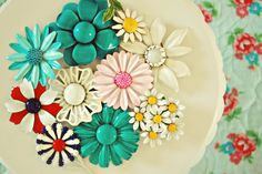 Pretty display of vintage enamel flower brooches.