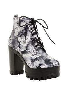 """<div>There will be no tiptoeing through tulips in these babies. You'll do nothing short of stomping! The platform booties have black and white floral print uppers and lace-up fronts.</div><div><ul><li style=""""list-style-position: inside !important; list-style-type: disc !important"""">Man-made materials</li><li style=""""list-style-position: inside !important; list-style-type: disc !important"""">1 3/4&..."""