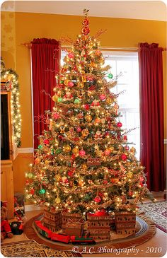 christmas tree with a train christmas xmas holiday decorating decor