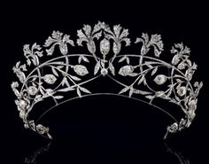 TIARA by Chaumet, circa 1908 - platinum, decorated with twelve carnations, foliage and flower buds, some mounted en tremblant, entirely set with old cut diamonds