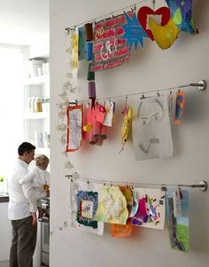kids drawings hung on ikea curtain wire
