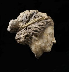 Head of Etruscan Woman.4th-3rd C. B.CE. Italy, Lazio, Terracotta, traces of paint and gilding