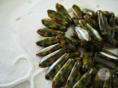 SAVE 10% use coupon code PIN10 Turtle shell Czech glass #bead daggers, lovely green and amber with a brown picasso touch what a beautiful addition to your jewelry.  Quantity: 20  Size: 15x5mm  Item#: 6DA-... #supplies