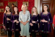 Camilla, Duchess of Cornwall (centre) meets the Tir na N-Og Irish Dancers, (left-right) Sarah White, Rose McAuley, Zoe McGarry, and Naomi Brown at a Music & Words for a Spring Evening at Hillsborough Castle during a visit to Northern Ireland on May 9, 2017 in Hillsborough, County Down, Northern Ireland. - Day One