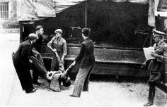 Warsaw, Poland, Removing corpses in the ghetto.