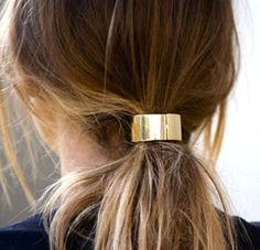 Add a unique touch of elegance by adding a hair cuff to a low-key ponytail.