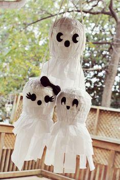 Use this tutorial to DIY ghost piñatas.