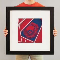 """This one is Fenway Park, but they are available for every major league venue, the prints are stylishly designed with the park and the surrounding streets and area set in the team's official colors. They're printed at 12"""" x 12"""" on a heavy paper stock that gives each print a metallic shimmer."""