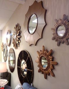 You can easily add color to and up-do cheap mirrors and a great way to fill up a big wall.