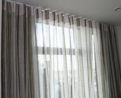 Sheer curtain in the front and blackout drapery behind them. Great way to have light but still hide the double track!