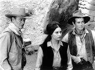 Stuart Whitman, John Wayne and Ina Balin in the 20th Century Fox western The Comancheros