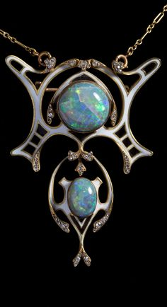 An Art Nouveau gold, enamel, opal and diamond pendant/brooch. 6 x 4.5cm. #ArtNouveau