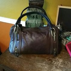 """Kate Landry Satchel This is a gorgeous satchel made of a soft supple brown leather. It had a zip top and 4 fun little zipper pockets on each corner. The strap is also a soft leather that doubles for comfort. Exterior is in great condition Interior is a little dirty. Strap drop is 11"""" hardware gold. Kate Landry Bags Satchels"""