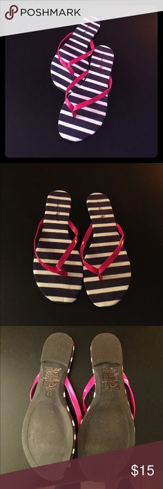 NWOT Navy blue/white stripe flip flops NWOT Navy blue/white stripe flip flops worth red accent. Bought from boutique and never wore. Super cute! Shoes