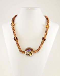 Purple flower and amber nuggets necklace $62.00 USD  by Dinglefritz