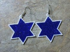Thewse pretty blue star earrings are done in the brick stitch with size 11 delica glass beads.The colors that I have used are white and silver lined