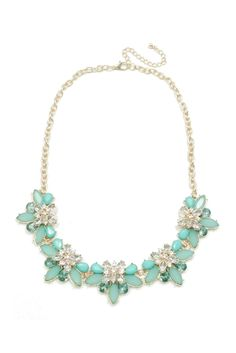 Mint colored petals dazzle on this statement bib necklace.  The necklace is approximately 16 inches, with a 3 inch extension.
