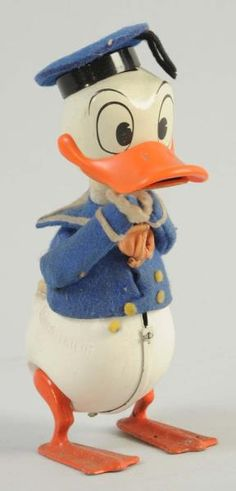 Vintage wind-up Donald Duck toy.