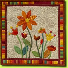 Gina's Garden by Regina Grewe (Germany): hand applique, hand embroidery, machine quilted.  Inspired by a pattern from The Sharon Rose Project.