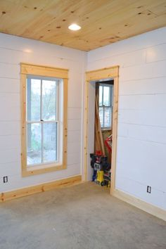 installing DIY shiplap walls and farmhouse trim from wood flooring