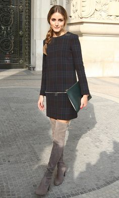 Fashionista Olivia Palermo is famous for sporting stylish ensembles and took the fun trend for a spin at Paris Fashion Week in a blue tartan shift dress with zipper detailing. She polished off the look with gray knee-high boots and a side-braid. Too cute. (Credit: KC Presse/Splash News)