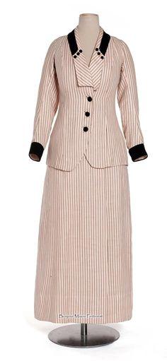 Suit, 1910. Pink & black striped linen canvas and wool twill. Photo: Jean Tholance. Les Arts Décoratifs via Europeana Fashion