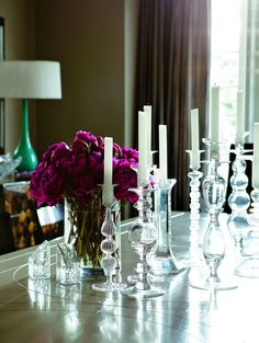 A collection of candlesticks in the dining room. Lantern Chandelier, Lanterns, Candlesticks, Candle Holders, Sweet Home, Ceiling Lights, House Styles, Modern Homes, Chandeliers