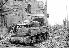 Two soldiers of the 743rd Tank Battalion, 30th Infantry Division, U.S. 9th Army, taking a break in Magdeburg Germany, April 17, 1945.