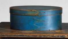 A rare, original meetinghouse blue painted finish highlights this fine oval Shaker box from either Sabbathday Lake or Alfred Maine. Primitive Antiques, Country Primitive, Shaker Furniture, Painted Furniture, Gift Drawing, Box Maker, Hearth And Home, Shaker Style, Trinket Boxes