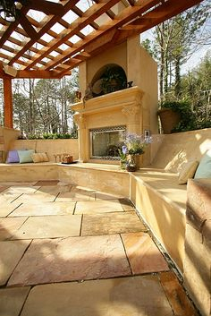 decking Makes for a fun and cheery patio! Such a gorgeous outdoor fireplace. Also love the seating, tile and pergola. Outside Living, Outdoor Living Areas, Outdoor Rooms, Outdoor Decor, Outdoor Kitchens, Outdoor Dining, Dining Area, Pergola Patio, Backyard Patio
