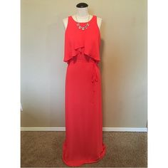 BCBG Maxi Dress sz XS NWT BCBG Maxi Dress sz XS NWTThe color appears more red in the images but it is actually a dark coral color. The actual name of the color is Poinsettia. The size is an XS but could also fit a size S because it runs on the larger side. It has an open back with a single button at the top and a tie waist. It is very long, I am 5'5 and would need to have it hemmed about 3-4 inches. The necklace is NOT included, sold separately.                                     NO TRADES…