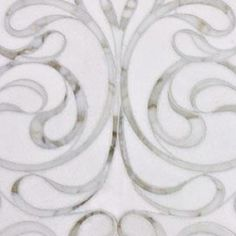 My favorite Waterjet mosaic from Artistic Tile!!   Artistic Tile offers so many different beautiful, unique tiles and mosaics. Great selection for kitchen or bath... Backsplash or floor/wall tile!!