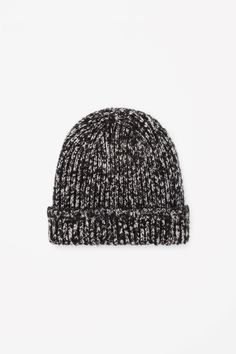 Made from a soft blend of wool and mohair, this chunky-knit hat has a soft, fuzzy texture.