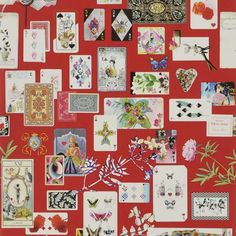 Maison de Jeu Wallpaper A luxurious wallpaper adorned with multicoloured antique playing cards set against a pillar box red ground. Maison de Jeu means 'gaming house' or 'house of cards'.
