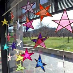 I love these gorgeous star sun catchers made with coffee stirrers and tissue paper found at the Carle Museum!