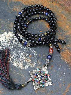 Mala made of 108, 8 mm - 0.315 inch, beautiful smooth and faceted onyx gemstones. The mala is decorated with onyx, carnelian, lapis lazuli and a Nepalese filigree dorje (vajra) pendant - look4treasures on Etsy