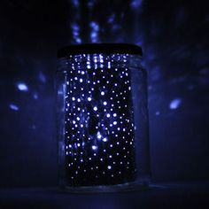 DIY Constellations In A Jar Tutorial. Really clever using a cheap LED light and a cheap foil pan. Real constellations are pierced into the foil.